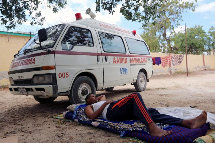 Aamin Ambulance driver Abdulkadir Abdulahi rests under a tree outside his house after returning from duty in Mogadishu