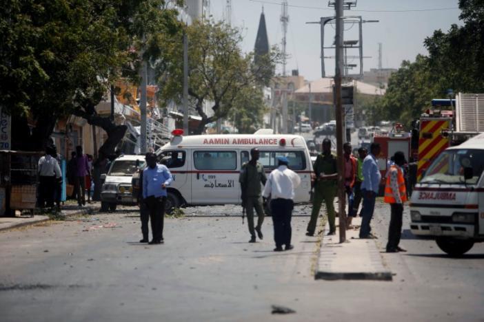 Aamin ambulances arrive near the scene of a suicide car explosion in Maka Al Mukarama street of Mogadishu