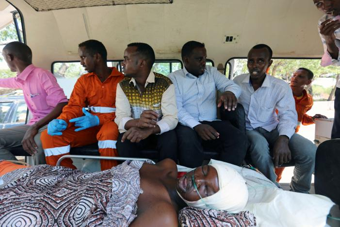 Mohamed Yusuf a paramedic at the Amin ambulances sits inside an ambulance as they evacuate a man wounded following a suicide car explosion in Maka Al Mukarama Street of Somalia's capital Mogadishu